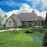 A luxury home with pond